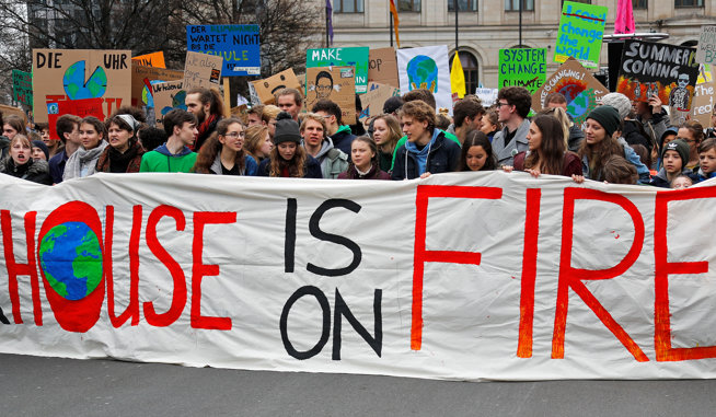 """Demonstrators take part in a """"Fridays for Future"""" protest claiming for urgent measures to combat climate change, in Berlin"""